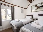 A bright and well-proportioned bedroom