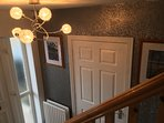 Entrance hall with artwork of local scenes available to purchase