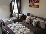Sumptuous brocade bedding feature in the triple room - Harrington.
