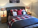 Sumptuous bedding, king size grey sleigh-bed feature in McIlroy.