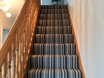 Stairs to 1st floor landing, living room and McDowell and Lowry bedrooms. 1st floor WC.