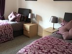 Sumptuous brocade bedding feature in the twin room - Lowry