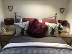 Sumptuous Egyptian cotton bedding feature in the king room - Clarke