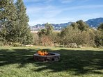 Backyard, view of Bridger Mountain Range and East Gallatin River with fire pit