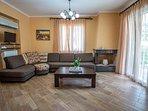 Ground floor: spacious living room with verandas towards the pool