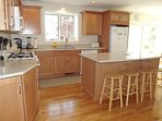 Another View of Kitchen Island and Dining Area