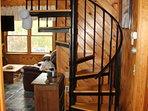 Spiral stairway to loft.
