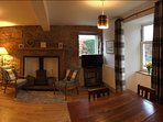 With many traditional features - coal fire, log burning stove, original stone walls.