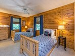 Twin bedroom with trundles under each bed.