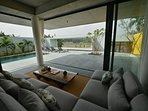 Informal low lounge looking out to terrace and to Thu Bon River.  Seamless indoor outdoor living.