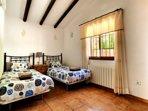 Tweede slaapkamer met 2 eenpersoonsbedden