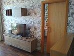 Salón comedor A/A, Calefacción, Internet, Smart TV, terraza soleada y comodísimo sofá cama de 135cm.