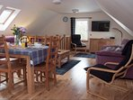 Open plan, warm and spacious living and dining area. All upstairs with views.