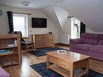 Upstairs lounge. 2x 3 seater settees. Lounge chairs. TV, DVD, music, games, maps, information.