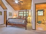 The bedroom boasts a king-sized bed.
