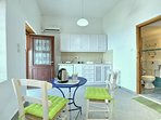 Casa JASMINE:- Angolo cottura attrezzato. Zona living.