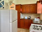 kitchen with fridge, stove & oven, microwave, coffee perk, kettle, toaster, blender etc.,