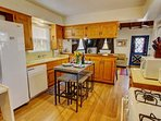 Kitchen with seating for four, dishwasher,  microwave,  12 cup coffee maker and lots of cookware!