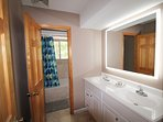 Main level bathroom with dimmable LED mirror
