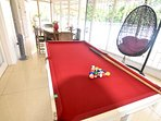 Pool table with dinning table which overlooks the swimming pool