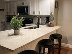 Kitchen island with quartz countertops.