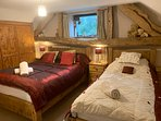The comfy family room with a full size double bed, single bed and an en-suite shower room.