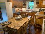 Seats 6-8 around the farmhouse kitchen table. Dishwasher and washing machine