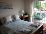 Terrace room with king size bed with patio doors to terrace and garden.