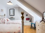 Our twin bedded room has a corner with children's toys, games and books