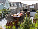 Our teak dining table and wicker style seats for 6 are perfect for al fresco dining