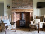 The living area with wood burning stove and tiles from Treberfydd House