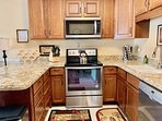 remodeled kitchen with granite counters, all new stainless steel appliances