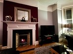 The Grand- living room with beautiful fireplace