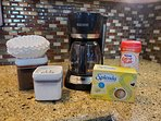A starter supply of coffee, filters, sugar, creamer and sweetener is provided.