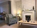 modern lounge . live in flame cosy fire . Tv  Play station . music system , modern décor