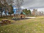 Community playground, basket ball hoop, badminton court, & picnic table