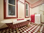 Antique claw-foot bathroom complete with heated floors and fluffy towels.