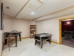 Game room with foosball table, lots of board games, books, and poker chips