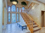 Grand entryway and staircase are great for family photos!