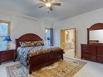 Spacious main floor master with a comfortable king size bed & en suite bathroom