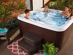 7-person hot tub on covered porch with additional 4-person tub in seclusion