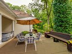 Plentiful outdoor seating with hot tub on covered porch