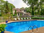 Fenced-in, heated saltwater pool with pool house & shower and plenty of seating