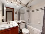 This home has a soaker jetted tub and a hand held shower.