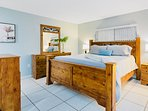 Master bedroom with a king sized bed and ensuite bathroom.