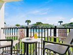 Walk right out to the pool and beach!  Note: The patio enclosure was removed during the recent balcony restoration...