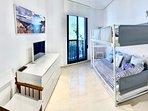 vista general dormitorio invitados con litera doble y una extra bajo suelo