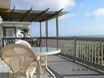 Large deck over looking the ocean with Shade area if needed