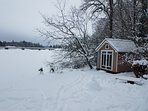 Boat shed overlooking Lake in winter