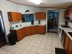 Large kitchen with all appliances and cooking utensils
